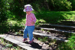 Baby First Steps. A baby girl takes her first steps Royalty Free Stock Photos