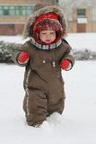 Baby first winter. A little baby boy in the snow on a cold winter day.. First winter for baby Royalty Free Stock Image