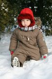 Baby first winter. A little baby boy in the snow on a cold winter day. First winter for baby Stock Photography
