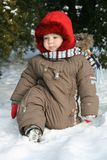 Baby first winter. A little baby boy in the snow on a cold winter day.. First winter for baby Royalty Free Stock Photo