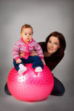 Baby on Fitness Ball. Moter hold baby on Fitness Ball Stock Photo