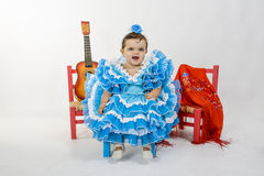Baby with flamenco dress. Is a typical Spanish baby dress stock images
