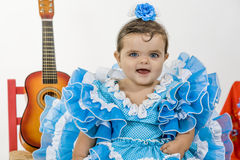 Baby with flamenco dress. Is a typical Spanish baby dress royalty free stock image