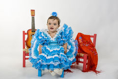 Baby with flamenco dress. Is a typical Spanish baby dress royalty free stock photo