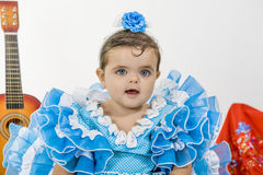 Baby with flamenco dress. Is a typical Spanish baby dress royalty free stock images