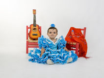Baby with flamenco dress. Is a typical Spanish baby dress Royalty Free Stock Photos