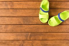 Baby flip flops on wooden background. Children`s shoes. the Con royalty free stock photography
