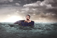 Baby Floating In The Middle Of The Sea stock photo