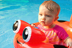 Baby Floating Staring Royalty Free Stock Photos