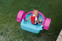 Baby Floats On A Toy Baby Boat. Attraction Stock Images