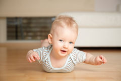 Baby on a floor. Baby crouching on a floow at home Royalty Free Stock Photos