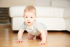 Baby on a floor Stock Photo