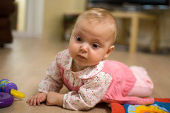 Baby on floor Royalty Free Stock Image