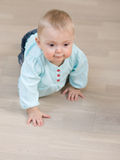 Baby on floor Stock Photography