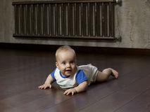 Baby on the floor Royalty Free Stock Photos