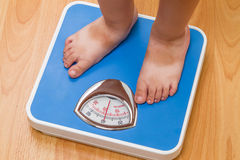 Baby on floor scales Stock Photo