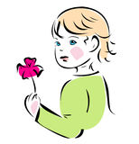 Baby with flower. Baby girl with flower in green pullover Royalty Free Stock Image