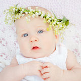 Baby and flower lily of the valley Stock Photo