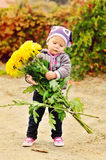 Baby with flowers Royalty Free Stock Photo