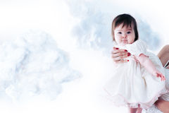 Baby flying Stock Photo