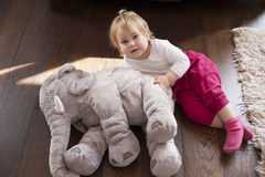 Baby flying with elephant plush doll Royalty Free Stock Photos