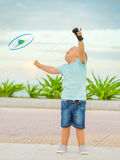 Baby with flying saucer Stock Photography