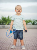 Baby with flying saucer. Boy with flying saucer outdoor. Leisure activity Royalty Free Stock Image