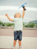 Baby with flying saucer. Boy with flying saucer outdoor. Leisure activity Royalty Free Stock Photo