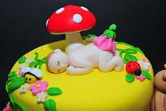Baby fondant figurine - cake details. Beautifully crafted cake with little animals fondant figurines Royalty Free Stock Image
