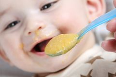 Baby with food Stock Photos