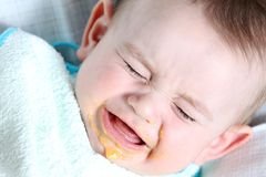 Baby with food Stock Photography