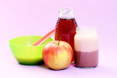 Baby food. Bowl of apple dessert and juice and jar of porridge - baby food Royalty Free Stock Image