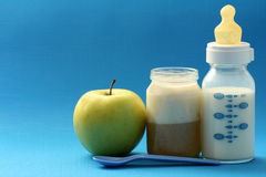 Baby food. Bottle of milk and jar of porridge - baby food Stock Photo