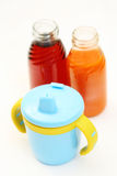 Baby food. Sip cup and two bottle of baby juice Stock Image