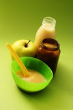 Baby food. Bottle of juice and jar of porridge - baby food Stock Image