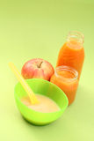 Baby food. Bottle of juice and jar of porridge - baby food Royalty Free Stock Image