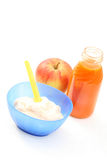 Baby food. Bottle of juice and bowl of porridge - baby food Royalty Free Stock Photos