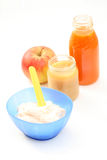 Baby food. Bottle of juice and bowl of porridge - baby food Royalty Free Stock Images
