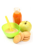 Baby food. Bottle of juice and bowl of apple - baby food Stock Photography
