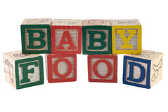 Baby Food. A sign that reads baby food, spelled using letter blocks, isolated against a white background Royalty Free Stock Image
