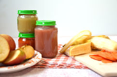 Baby food, baby fruit mashed in a glass jar, sliced carrot slices, apple, banana Stock Photo