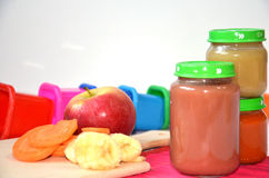 Baby food, baby fruit mashed in a glass jar, sliced carrot slices, apple, banana Royalty Free Stock Photography