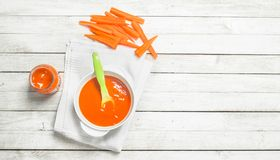 Baby food. Baby puree from fresh carrots with a spoon. stock photos