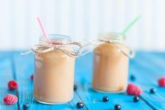 Baby food. Banana and peach puree in mason jar Stock Image