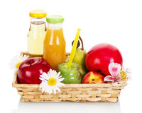 Baby food basket: juices, purees and fruit isolated on white. Stock Photo