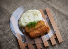mashed potatoes with fish sticks Stock Photos