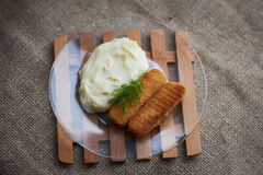 mashed potatoes with fish sticks Royalty Free Stock Photo