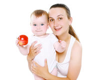 Baby and food concept - happy mother with her infant Royalty Free Stock Images
