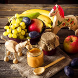 Baby food, fruits and toy on wooden table. stock photo