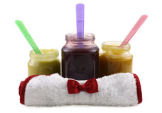 Baby food jars with bib Royalty Free Stock Photo